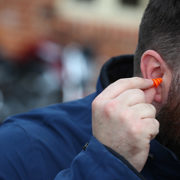 Inserting Auritech filtered ear plugs